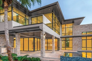 Modern style home with Marvin Signature Coastline Casement Awning and Picture Windows and Marvin Signature Coastline Multi-Slide Door