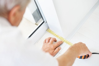 Man measuring for Marvin Signature Coastline Window Replacement